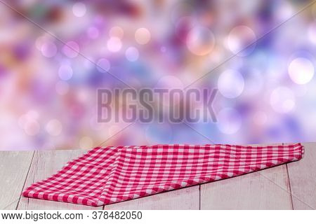 Empty Table Product. Closeup Of A Empty Red Checkered Tablecloth Or Napkin On A Rustic Bright Table