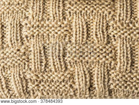 Knitted Background. Knitted Texture. A Sample Of Knitting. Knitting Pattern