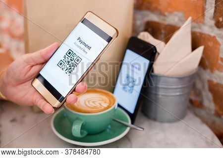 Customer Hand Using Smart Phone To Scan Qr Code Tag On Another Smart With Coffee In Coffee Shop Or R