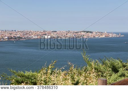 View Of The Historic Waterfront Of Lisbon From From The Other Side Of The River.