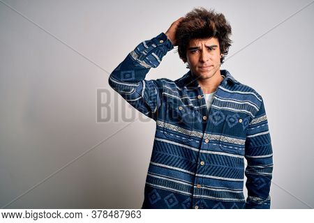 Young handsome man wearing casual shirt standing over isolated white background confuse and wonder about question. Uncertain with doubt, thinking with hand on head. Pensive concept.