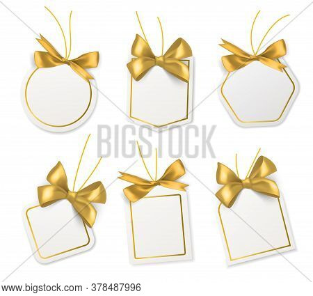 Tags With Gold Bows. Blank White Price Paper Labels With Golden Satin Or Silk Ribbons For Christmas,