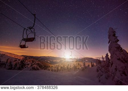 An Empty Ski Resort With Funiculars Located On Winter Hills Against The Backdrop Of The Starry Sky A