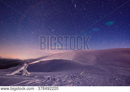 Stunning Beautiful Views Of The Slopes In The Ski Resort After Sunset In The Late Evening. The Conce