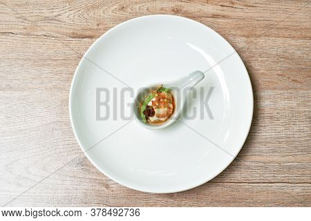 Fresh Oyster Eating Couple Acacia Leaf And Fried Slice Shallot Dipping Spicy Sauce In Spoon On Plate