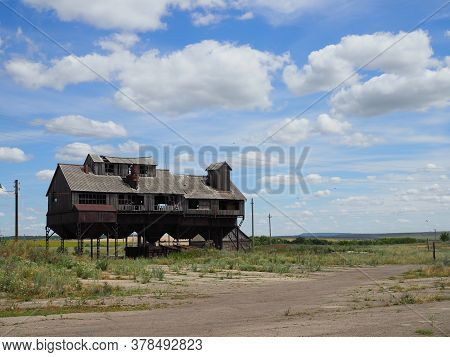 Old Abandoned Grain Elevator Of Unique Design In The Wheat Fields
