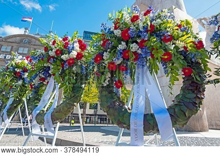 Amsterdam, Netherlands - May 5, 2020: Wreaths at the National Monument on the occasion of remembrance of the worldwar II in Amsterdam the Netherlands
