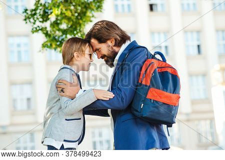 Father Takes Child To School. Back To School Concept. Schoolboy Go To First Class. Education, Elemen