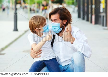 Dad And Schoolboy Wearing Face Mask. Schoolboy Is Ready Go To School. Coronavirus Pandemic. Family,
