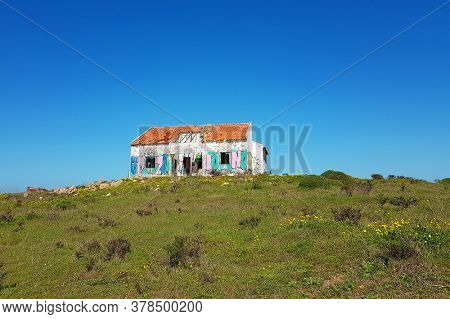 Desolated old ruin on a hill in the countryside in spring