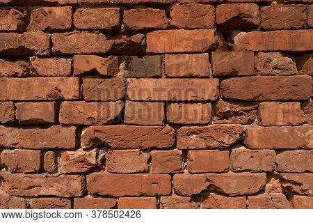 Background From Very Old Red Brickwork. Wall Without Cement Joints.