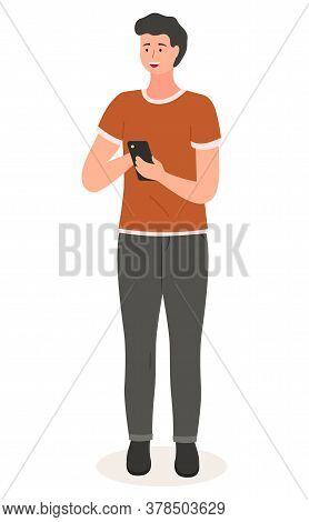 Young Handsome Man In Casual Clothes Standing At Full Height, Holding A Mobile Phone In His Hands, V
