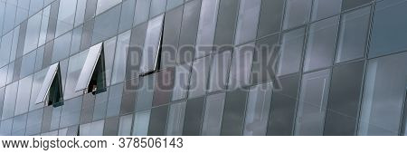 Fashionable Architecture Of Commercial Skyscraper Wall With Grey Decorative Panoramic Windows And Sk
