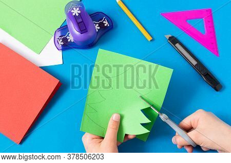 Child Makes Card With Christmas Tree. Original Art Project For Children. Diy Concept. Step-by-step P