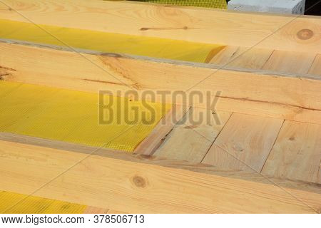 Installing Vapor Barrier Or Damp Barrier Membrane Under Wood Braces, Boards While Constructing The R
