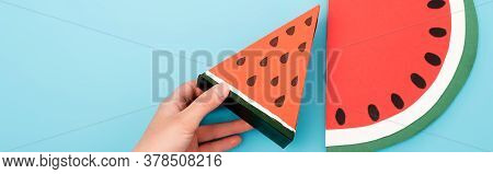 Partial View Of Female Hand With Paper Watermelon Slices On Blue Background, Panoramic Shot