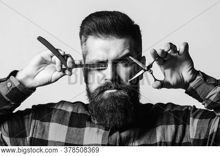 Brutal Barber With Straight Razor And Scissors. Bearded Guy Holding Proffecional Tools. Barber Shop.