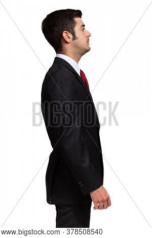 Lateral portrait of an hypnotized business man. Isolated on white