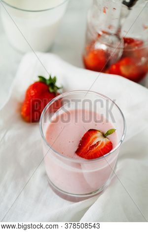 Organic Probiotic Milk Kefir Drink Or Yogurt With Strawberry In Glass On The White Grey Background.