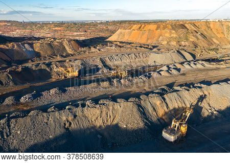 Quarry Extracting Iron Ore With Heavy Trucks Excavators Diggers And Locomotives Aerial View