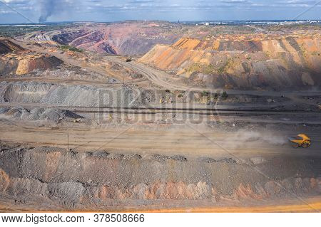 Heavy Dump Truck Carrying The Iron Ore On The Opencast Mining Aerial View