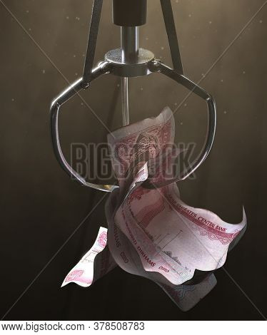 A Robotic Claw From An Arcade Type Game Gripping A Wad Of Creased Uae Dirham Bank Notes On A Dark Mo