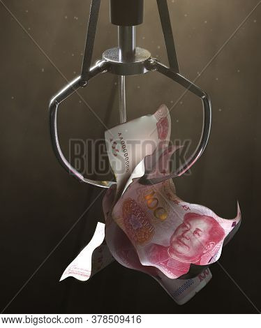 A Robotic Claw From An Arcade Type Game Gripping A Wad Of Creased Chinese Yuan Bank Notes On A Dark