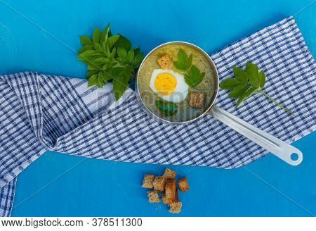 Summer Green Soup Of Wild Grass Aegopodium With Boiled Egg And Crackers In A Ladle, Top View