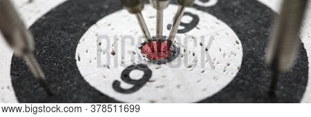 Close-up Of Dart Board. Darts Hitting In Reaching Central Target. Excitement. Black And White Chipbo