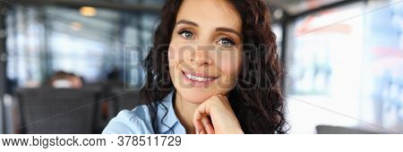 Portrait Of Smiling Woman Looking At Camera With Happiness And Gladness. Happy Female Person With Cu