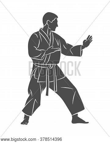 Man In Kimono Training Karate On A White Background