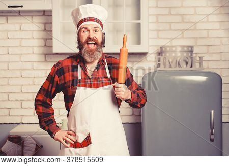 Handsome Bearded Cheef Cook Prepairing Spaghetti On A Kitchen. Chef Cooks Meal.