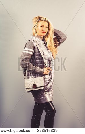 Woman In Spring Jacket With A Handbag. Portrait Of A Blonde In Autumn Jacket.