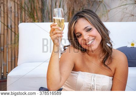 emotional girl with a glass of champagne during pandemic isolated
