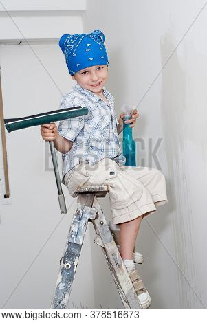 young boy clean the room during repairs