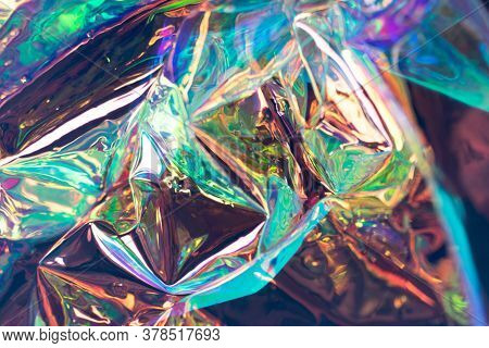 Colorful Blurred Holographic Background. Wrinkled Fluid Foil Texture. Soft Focus Pearlescent Psyched