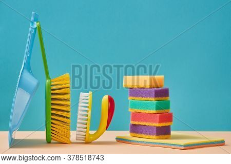 Cleaning Supplies. Sweeping. Housekeeping Concept. Stack Of Sponges And Rags. Trowel And Brush With