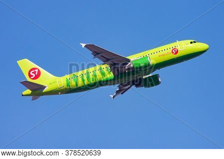 Hong Kong / China - December 1, 2013: S7 Airlines Airbus A320 Vq-brg Passenger Plane Departure And T