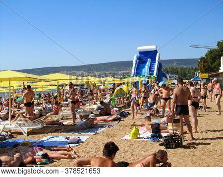 Crimea, Feodosia, July 26, 2012. City Beach, Many People Sunbathe And Relax By The Sea On A Hot Summ