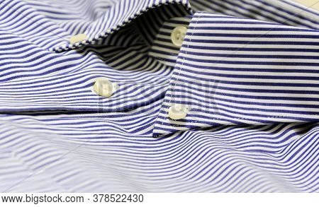 A Blue Striped Shirt With A Button Down Collar. Formal Wear For Events Or Work And Business Meetings