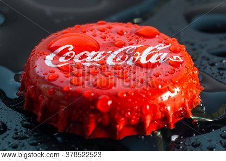 Tyumen, Russia-june 11, 2020: Logo Of Coca-cola Is A Carbonated Non-alcoholic Beverage Cold All Over