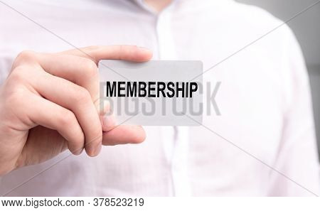 Membership Text Is Written On The Card That The Businessman In White Shirt Hold In His Hands. Busine