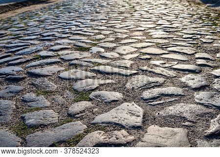 Granite Cobblestones Of A Country Road In Poland