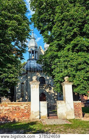 Historic Parish Church With Two Bell Towers In The Village Of Stary Dworek In Poland