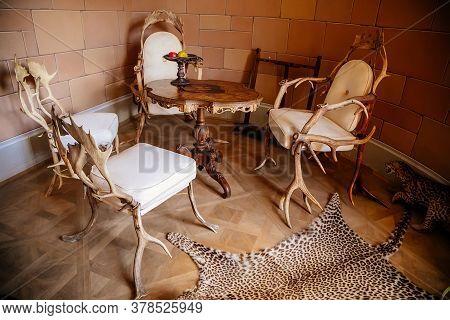 Castle Interior. Mule Deer Antler Furniture In The Tearoom. Castle Bitov, South Moravia Region, Czec