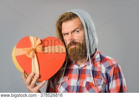 Man Holds Valentines Gift Box In Shape Of Heart. Bearded Man Holds Heart Gift Box. Present With Love