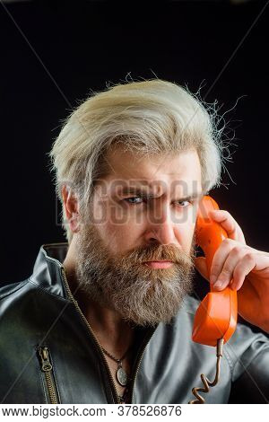 Communication. Handsome Man Talking At Retro Handset. Bearded Man With Handset. Male Talking On Land
