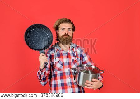 Kitchenware. Cooking Vessels. Kitchen Advertising. Bearded Man With Saucepan Frypan. Man Chef With P