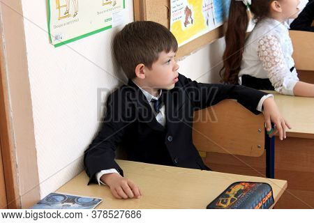 Moscow, Russia - September 1, 2017: Schoolboy, Pupil Sitting At The Desk In Class At School, Traditi
