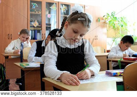 Moscow, Russia - September 1, 2017: Schoolgirls Sitting At The Desk In Class At School, Traditional